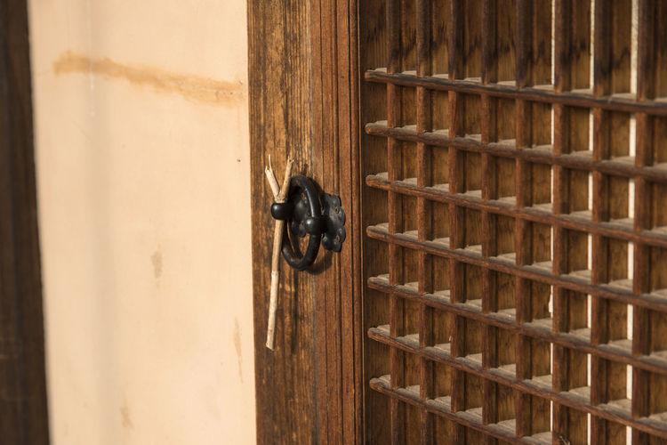 Close-up of wooden ajar door