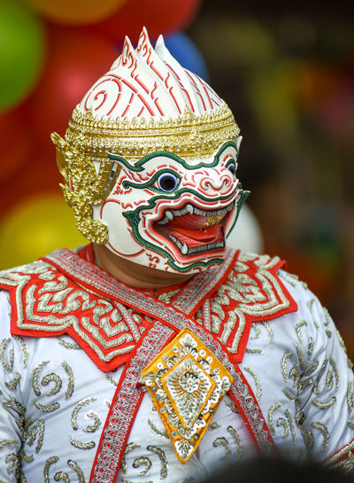 Person wearing mask during festival
