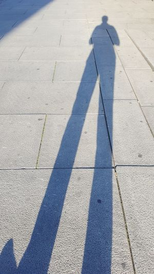 Low section of man on shadow
