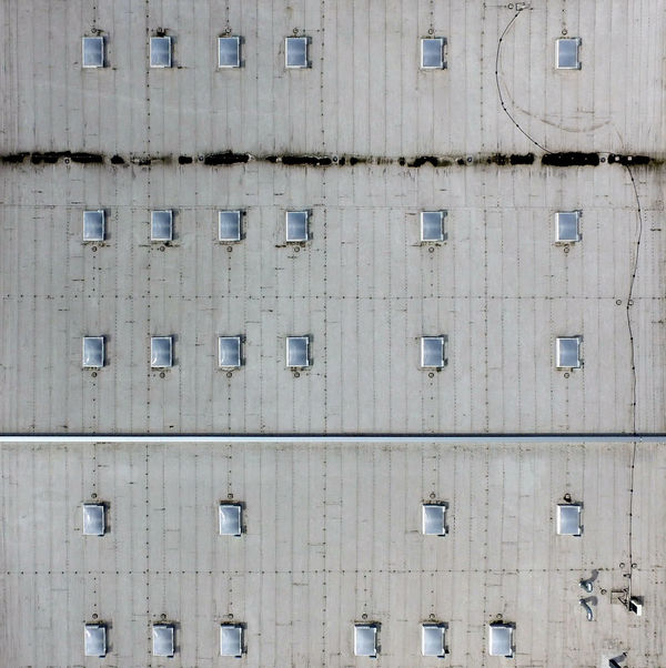 Aerial view of the flat roof of an industrial hall, as background Fly Graphic Above Abstract Architecture Background Backgrounds Building Building Exterior Built Structure Day Full Frame Geometric Grey Hall Indusrty Metal No People Outdoors Pattern Side By Side Vertical Wall - Building Feature Window Wood - Material