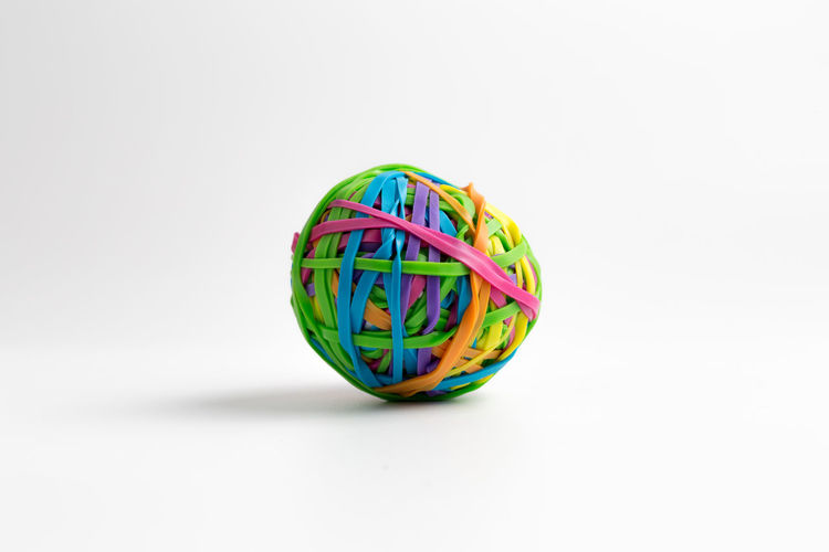 Close-up of multi colored ball against white background