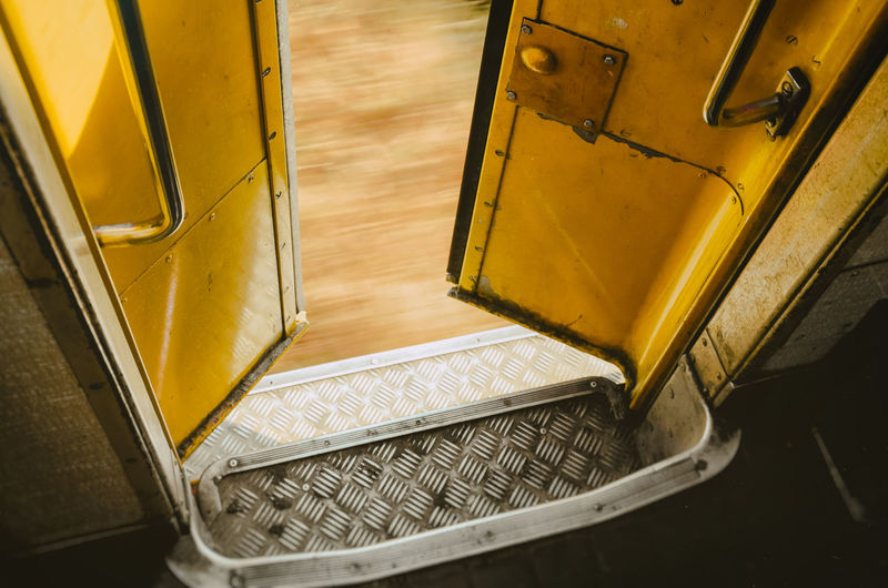 High angle view of yellow open bus door