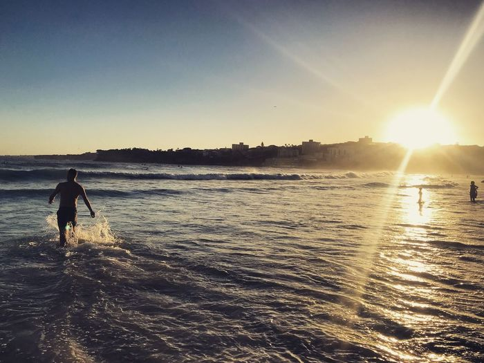 Sunset swim Model Man Evening Summer Warm Shore Sea Waves Swimming Happiness Bondi Beach Fresh Ocean Water Real People Sunlight One Person Beauty In Nature Land Lifestyles Beach Sunset Nature Leisure Activity Lens Flare Sun Sea Silhouette Outdoors Scenics - Nature