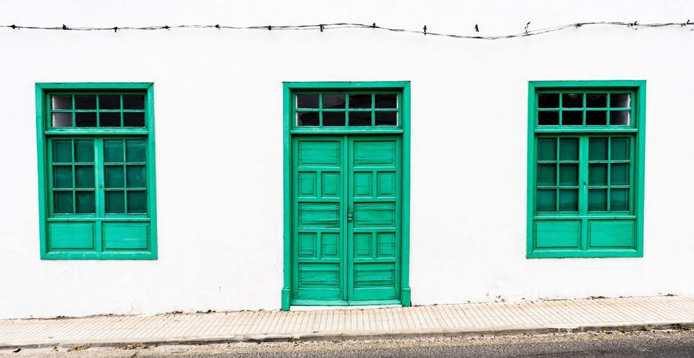 Green door on the Spanish island Lanzerote. Building Exterior Architecture Built Structure Window No People Outdoors Day Residential Building Green Contrast Empty Beautiful City Village