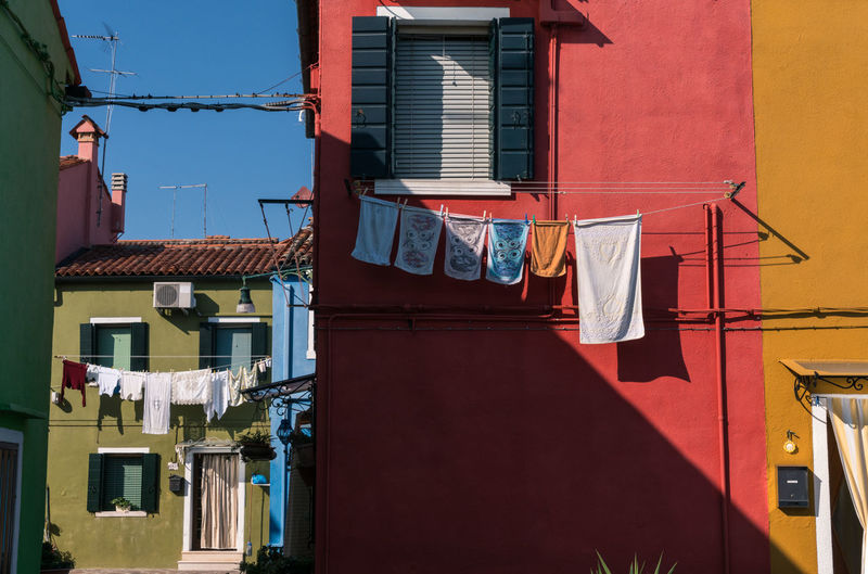 Architecture Burano, Venice Colors Italia Shadow And Light Travel Travel Photography Venezia Venezia, Italia Venice, Italy Burano Clothesline Color Colorful Day Hanging Italy Laundry No People Outdoors Photography Shadow Streetscape Venice Window
