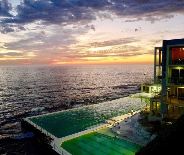 Sunrise over Bondi Icebergs Club swimming pool in Sydney. Sydney, Australia Icebergs, Bondi Beach Sunrise And Sea Sunrisereflection Swimming Pool Outdoor Swimming Pool First Eyeem Photo