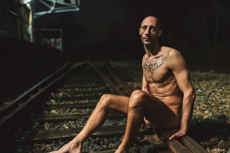 Train Tracks 🛤 Eye Contact Sony A7RII full frame Art is Everywhere This Is Masculinity Eye Contact Sony A7RII Full Frame Healthy Lifestyle Body & Fitness Body Curves  Nude_not_porn Nude_model Light And Shadow Night Photography Train Tracks Young Man Italian Model Bald Man Bald Head Male Model Model Muscular Build Shirtless Sitting Lifestyles Strength Real People Exercising One Person Night Portrait Outdoors People