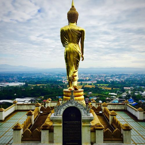 Never Look Back🙏🙏🙏 Statue Budda Statue Buddha Temple Gold Colored Cityscape Sculpture Sky Outdoors City Cityscape From The Back NAN Thailand Thailand Travel Destinations No People Cloud - Sky Watprathatkaonoi วัดพระธาตุเขาน้อย น่าน