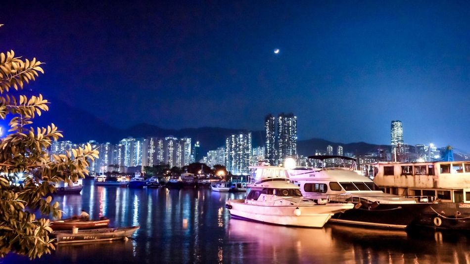 Floating in the new world Hong Kong Marina Lei Yue Mun Fishing Village Night Illuminated Moon Boats Ocean Waterfront Reflection Built Structure Cityscape Skyscraper Nightphotography Connected By Travel