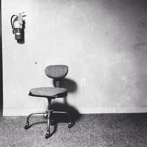 Office chair against wall
