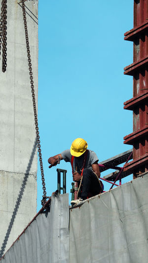 Low angle view of worker working at construction site
