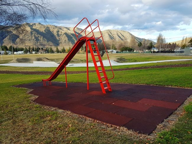 Playground Playground Childhood Outdoor Play Equipment Sky Child Day Children Only Grass Goal Post Outdoors People Oil Pump Freshness Let's Go. Together. Vacations Scenics Travel Destinations Tourism Travel Landscape Beauty In Nature Grass Mountain Cloud - Sky No People