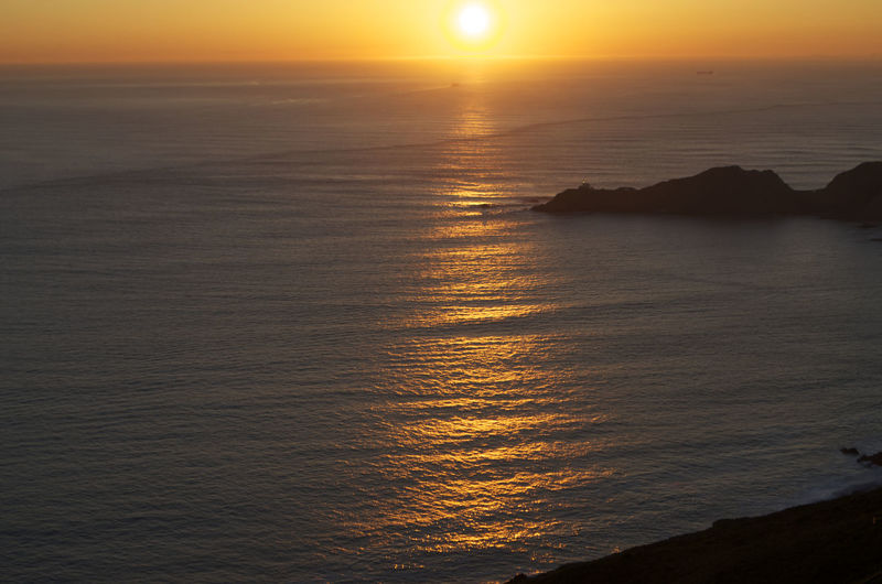 The beauty of sunset Beauty In Nature Day Horizon Over Water Nature No People Orange Color Outdoors Scenics Sea Sky Sun Sunlight Sunset Tranquil Scene Tranquility Water California Dreamin