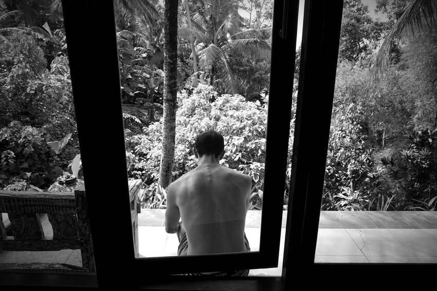 In Bali. Window Rear View Real People Indoors  One Person Standing Shirtless Day Tree Looking Through Window Lifestyles Men Architecture Human Back People