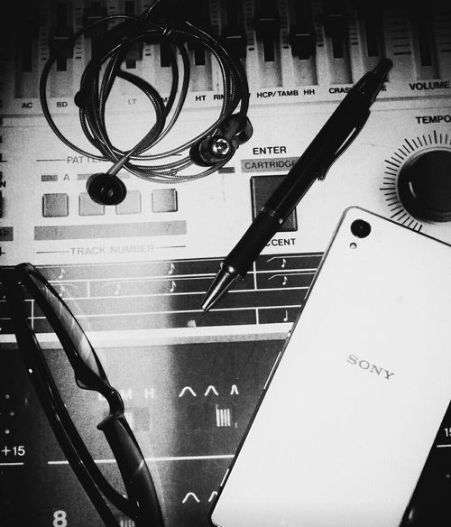 A collection of the daily necessities. Songwriting Notebook Glasses Pen Smartphone Sony XPERIA Bassbuds Earphones Gettowork Music Writing Creative Inspiration Connect Express Enjoy Mobile Conversations Blackandwhite