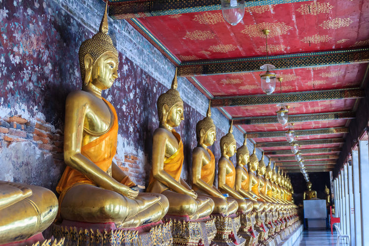 Beautiful golden Buddha images at corridor in Wat Suthat temple, Thailand. Wat Suthat Thepphawararam is a royal temple of the first grade in Bangkok. Construction of the temple was completed in 1847. Corridor Picture Golden Buddha Image Temple Golden Buddha Head Golden Buddha Image Wat Suthat Wat Suthat Thepwararam Architecture Art And Craft Belief Building Built Structure Corridor Walk Creativity Gilded Gold Gold Colored Golden Buddha Golden Buddha Statue Golden Buddhas Human Representation Idol Male Likeness No People Ornate Place Of Worship Religion Representation Sculpture Spirituality Statue