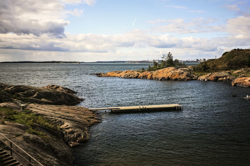 Baltic Sea Beach Boat Coast Coastline Distant Exploring Fortress Horizon Over Water Incidental People Island Jetty Nautical Vessel Ocean Outdoors Pier Remote Rippled Sea Shore Stone Tranquil Scene Vacation Water