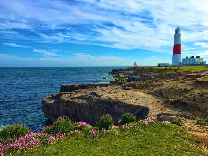 Portland Bill. Landscape_Collection Landscape_photography Scenics Horizon Over Water Lighthouse Coastline Sea Sky Relaxing Check This Out Photography Nature Dorset Outdoors England Idyllic Dramatic Sky Bestoftheday Jurassic Coast All_my_own Green Blue Water Beautiful Beauty In Nature