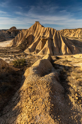 Scenic view of arid landscape against sky. bardenas reales. spain