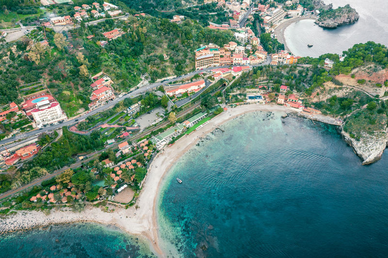 High angle view of buildings by sea