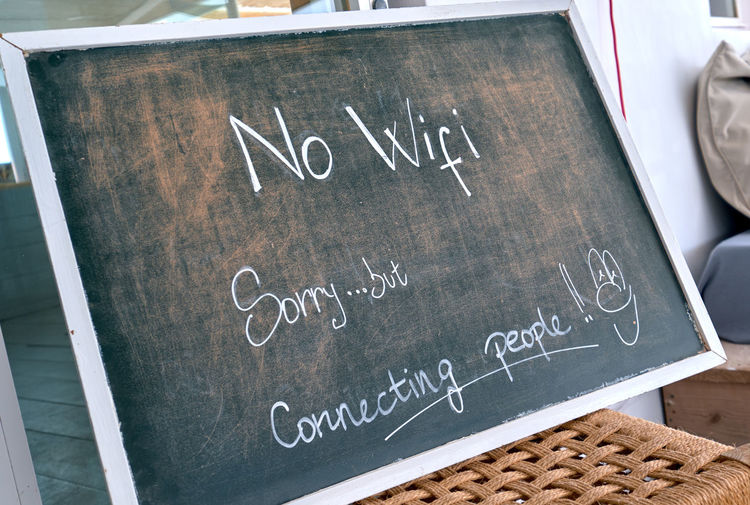 No Wi Fi sign. Sorry, but connecting people - chalk text written on blackboard at restaurant. Talk to each other concept Forbidden No Signal Blackboard  Board Chalk - Art Equipment Close-up Communication Conceptual Connecting People Conversation Handwriting  Information Message No Wi-Fi No Internet No People No Wi Fi No Wi-fi Signal Offline Prohibition Talk To Each Other Text Wi Fi Wi-fi Wi-fi Disabled