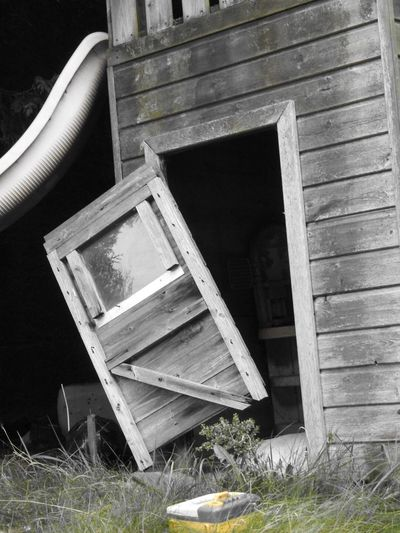 Wood - Material Abandoned Grass No People Outdoors Day Built Structure Architecture Folding Chair Building Exterior Open Door Nature Childhoodsend