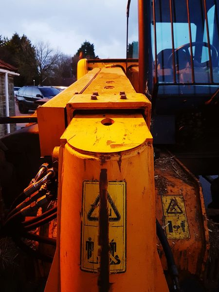 Well used Metal Sky No People Outdoors Close-up Loading And Unloading Arm Loading Machinery Machine Plant Handlers Telescopic JCB Heavy Duty Heavy Duty Equipment Duty Heavy Land Vehicle Mode Of Transport Transportation Cab Safety First Safety Sign Hazard Signs