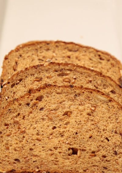 Brown multigrain bread slices on a white plate Multigrain Bread Bread Bread Slices Carbohydrates Close-up Fiber Food Food And Drink Freshness Healthy Healthy Bread Healthy Eating Indoors  Multi-grain Bread Multigrain Multigrainbread No People Ready-to-eat Sliced Bread Whole Wheat Bread