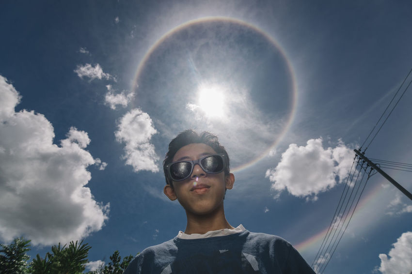 Hello Halo. Cloud - Sky One Person Headshot Sky Human Body Part Rainbow People Portrait Day One Man Only Outdoors Only Men Boy Halo Halo Around The Sun Children Photography Children's Portraits Children Halo Effect Halosolar Sun ☀ Child Low Angle View Face