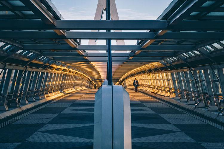 Full length of man walking on bridge