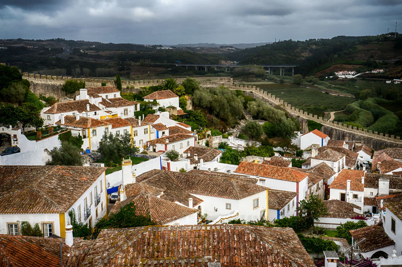 High angle view of houses against cloudy sky at obidos