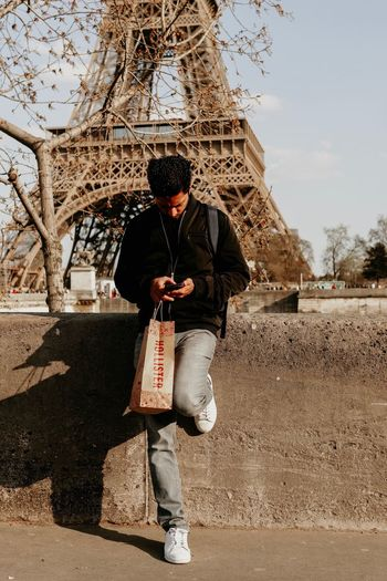 Paris Eifel Tower Full Length Real People One Person Leisure Activity Lifestyles Standing Built Structure Men Architecture Day Males  Sky Front View Child Casual Clothing Sunlight The Art Of Street Photography