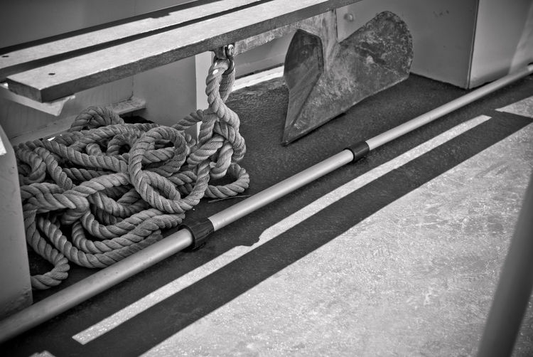 Rope Strength No People Tied Up Day Connection Nautical Vessel Transportation Close-up Tied Knot Pattern Mode Of Transportation Outdoors Twisted High Angle View Nature Wood - Material Durability Industry Ship Row Shadow Photography Eyeem Water Collection Eyeem Travel Monochrome