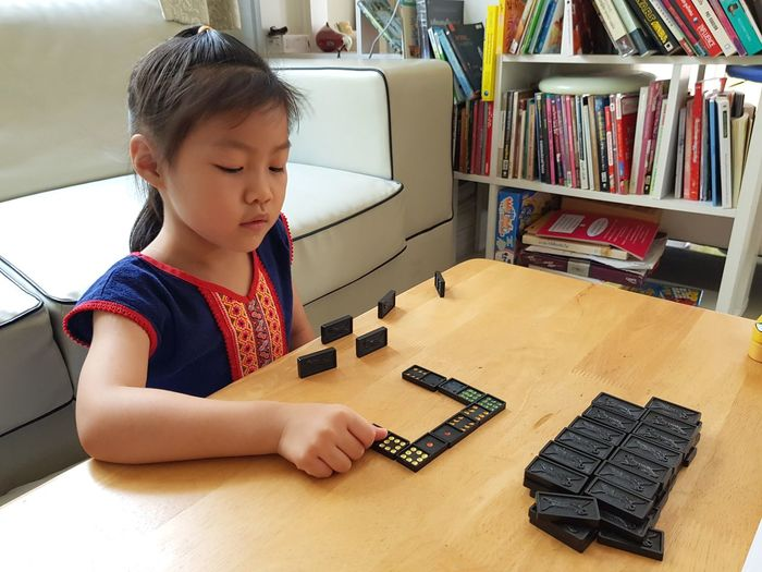 Cute girl playing on table