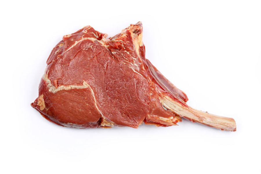 Tomahawk beef steak on rib over white, close up, elevated top view,T Beef Steak Cuisine Isolated Market Meat! Meat! Meat! Raw Red Background Beefsteak Bone  Close-up Cut Out Directly Above Food Food And Drink Freshness Meat Portion Raw Food Rib Steak Tomahawk Tomahawk Steak White White Background