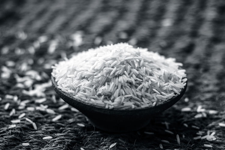 Uncooked White Basmati rice in a clay bowl.; Asian  Asian Culture Basmati Rice Cereal Dinner Dish Rice Clay Clay Bowl Close-up Day Food Freshness No People Uncooked Food Uncooked Rice
