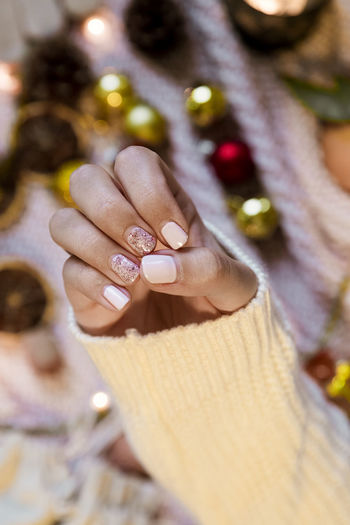 Christmas Decoration Christmas Decoration One Person Hand Jewelry Nail Polish Human Finger Close-up Nail Art Fingernail Beautiful Woman Manicure Cosy Wintertime