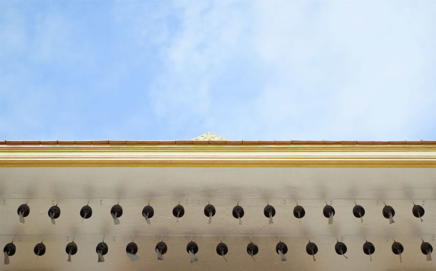 Row of bell on roof of temple Golden Mountain in Bangkok Thailand with blue sky and cloud. Ancient Antique Asian  Bell Bronze Buddha Cloud East Gold Golden Roof Thai Thailand Blue Copy Space Culture Decoration Metal Nature Religion Sky Steel Temple Temple Golden Mountain Traditional