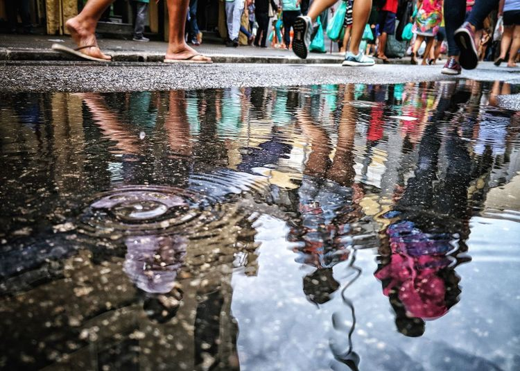 Water Low Section Men Puddle Reflection Wet Oil Spill Water Pollution Sewage Gutter Manhole  Environmental Damage Water Conservation Drum - Container Drain Pollution Sewer Leaking Muddy Footwear Human Leg Rainy Season Monsoon Human Foot Flood Personal Perspective