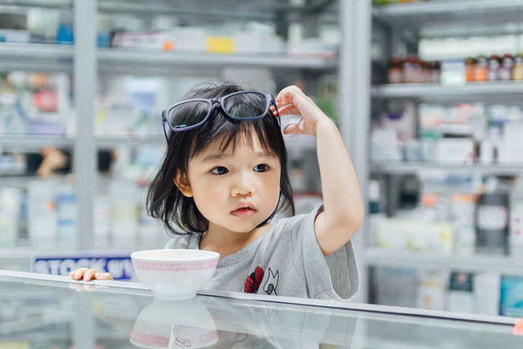 Asian Girl Childhood Children Only Close-up Day Focus On Foreground Food Food And Drink Freshness Front View Frozen Food Headshot Holding Ice Cream Indoors  Looking At Camera One Person People Portrait Real People Shelf