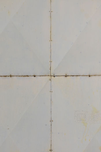 old metal surfaces connected in middle Metal Surface Old White Connected Middle Texture Rust Rusty Grunge Background Rusting Obsolete Grime Material Backdrop Abstract Rustic Wall Weathered Damaged Stain Rough Pattern Aged Closeup Decay Vintage Sheet Abandoned Retro Oxidation Textured  Panel Industrial Construct Macro Structure Worn Wallpaper Element Industry Plate Brass Connection Vertical Full Frame White Color