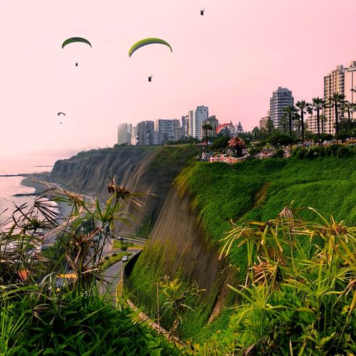 Sunset at Miraflores, Lima. Multi Colored Adventure Paragliding Flying Extreme Sports Nature Day People Urban Skyline Scenics Travel Destinations Parachute Skyscraper
