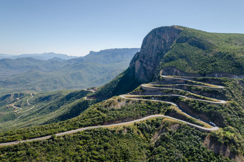 The impressive Serra da Leba pass in Angola. The road gains altitude quickly over several serpentines. Curve Landscape_Collection Pass Road Aerial View Beauty In Nature Clear Sky Day Green Color High Angle View Landscape Mountain Mountain Range Nature No People Outdoors Rural Scene Scenics Sera Da Leba Sky Tranquil Scene Tranquility Travel Destinations Tree Winding Road Been There. The Week On EyeEm