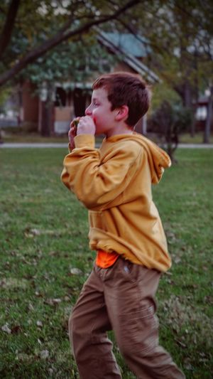 Photo essay - A day in the life. Southeast Nebraska October 2016 - Eating Watermelon and running around at the same time... what??? Americans Autumn Camera Work Casual Clothing Cookout Eating Everyday Lives Eye For Photography EyeEm Best Shots EyeEm Gallery Focus On Foreground Front Yard View Holding Kids Being Kids Leisure Activity Lifestyles Photo Essay Photography Rural America Small Town Stories Three Quarter Length Visual Journal