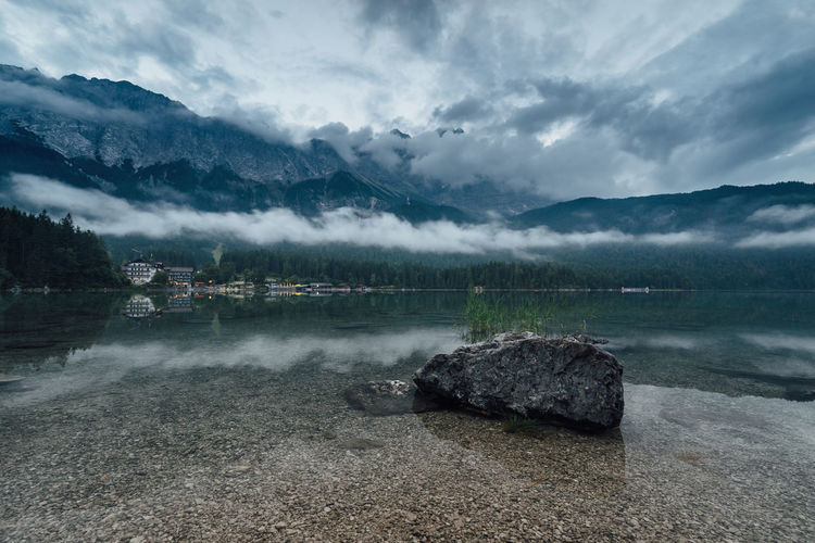 Alpen Eibsee Moody Sky Alps Beauty In Nature Cloud - Sky Environment Idyllic Lake Mood Mountain Mountain Range Nature No People Non-urban Scene Outdoors Rock Rock - Object Scenics - Nature Sky Solid Tranquil Scene Tranquility Water