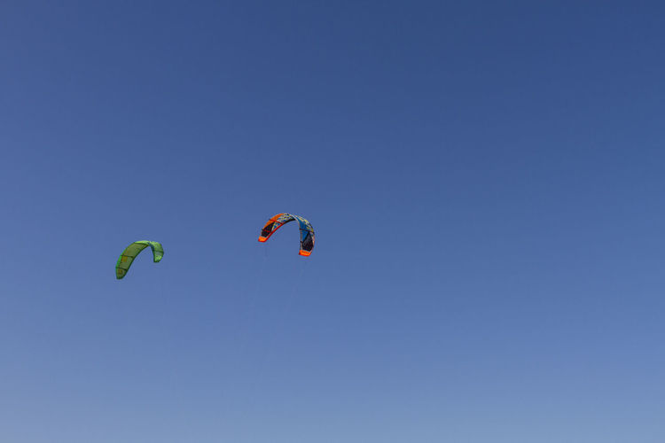 Adventure Blue Clear Sky Extreme Sports Flying Leisure Activity Low Angle View Mid-air Outdoors Paragliding Sky Sport