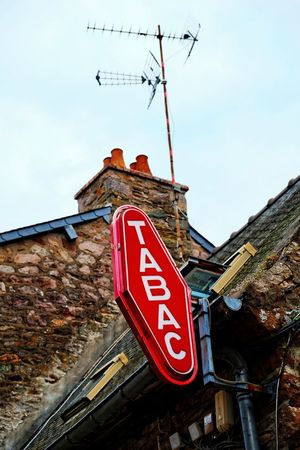 tabac Lawoe Communication Low Angle View Building Exterior Architecture Text Sky Red Building Day House Roof Capital Letter Information Sign France