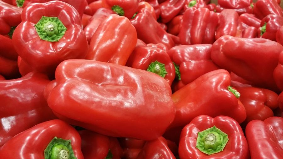 Full frame shot of red bell peppers for sale in market