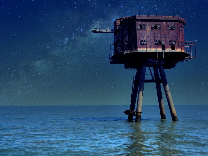Scenic view of a seafort against sky at night
