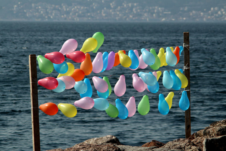 Close-up of multi colored balloons on beach